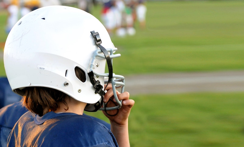 football player in helmet at risk for concussion