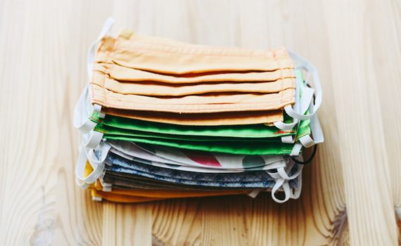 stack of face masks for COVID-19 protection