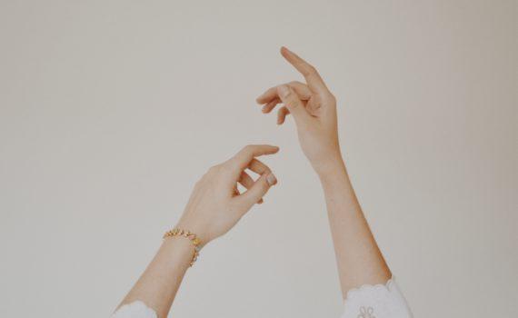 hands against white background arthritis flares